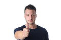 Good looking young man with thumb up doing ok sign attractive isolated on white background Royalty Free Stock Image