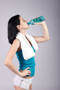 Good looking young woman drinking water Stock Images