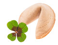 Good luck fortune cookie with cloverleaf isolated over a white background Stock Photo