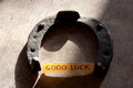 Good luck inscription and horseshoe over wooden background Royalty Free Stock Images