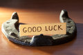 Good luck inscription and horseshoe over wooden background Royalty Free Stock Photo