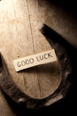 Good luck tag and horseshoe over wooden background Royalty Free Stock Photo