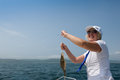 Good luck the woman captain on fishing Royalty Free Stock Image