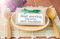 Good morning beginning with breakfast tag on dish spoon flower on wooden background Royalty Free Stock Photo