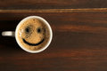 Good morning coffee smile cup on wooden background Royalty Free Stock Photo