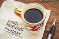 Good morning monday on napkin handwriting a with a cup of coffee Royalty Free Stock Images