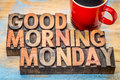 Good morning monday in vintage letterpress wood type blocks with a cup of coffee Stock Photos