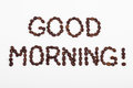 Good morning text in coffee beans on a white backround Royalty Free Stock Photography