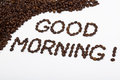 Good morning written with coffee beans on a white background Stock Photography