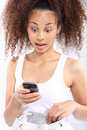 Good news dark skinned girl reads sms surprise a Royalty Free Stock Photography