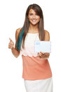 Good news for you concept trendy young smiling woman giving blank envelope and gesturing thumb up over white background shallow Stock Photo