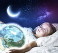Good night girl at the bed with earth planet in hands elements of this image are furnished by nasa Royalty Free Stock Image