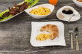 Good and solid breakfast with bacon, scrambled eggs, coffee and Royalty Free Stock Photo