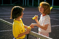 Good sportsmanship two girls at summer camp enjoy a game of tennis and demonstrate after a match Royalty Free Stock Images