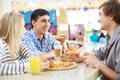 Good time image of teenage friends interacting in cafe Stock Photography