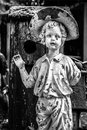 Goodbye eerie statue boy garden waving black white Royalty Free Stock Photography