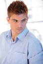 Goodlooking young man in shirt portrait of with stylish hairdo Stock Photography