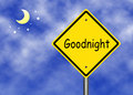 Goodnight text road sign against night background Royalty Free Stock Image