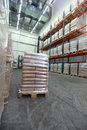 Goods delivery sacks on wooden pallet inside storehouse Stock Images