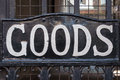 Goods sign close up on a metal gate Royalty Free Stock Photo
