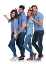 Goofy casual group of young people inviting you to the fun on white background Stock Photography