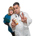 Goofy Doctor and Nurse with Prescription Bottle Isolated on a Wh Royalty Free Stock Photo