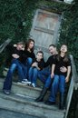 Goofy family portrait up close view of american in black shirts and denim blue jean pants of five being during a Stock Image