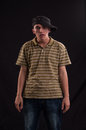 Goofy teenager wearing cap with a funny expression on hi trendy his face Stock Photos