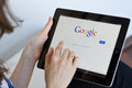 Google search woman performs a on digital tablet Royalty Free Stock Photos