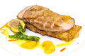 Goose breast cooked on griles tangerine sauce on a white background in restaurant Stock Images