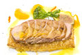 Goose breast cooked on griles tangerine sauce on a white background in restaurant Royalty Free Stock Photos