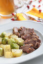 Goose breast with vegetables and beer Stock Images
