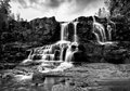 Gooseberry falls black and white in the rain lower along minnesota s north shore Stock Photos
