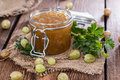 Gooseberry jam in a glass with fresh fruits Stock Photo