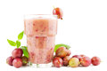 Gooseberry smoothie big glass of fresh with red gooseberries on white Stock Image