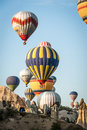 Goreme balloons colourful flying over the fairy chimneys of in turkish region of cappadocia Royalty Free Stock Images