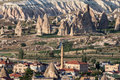 Goreme minaret fomations turkey the fantastic dunes with like formations and the housing of village in cappadocia Stock Photography