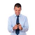 Gorgeous adult man texting with his cellphone Royalty Free Stock Photography