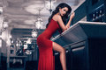 Gorgeous beauty young brunette woman in red dress Royalty Free Stock Photo