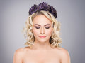 Gorgeous blond with closed eyes wearing a purple flower crown Royalty Free Stock Photo