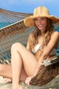 Gorgeous blond woman relaxing in a hammock Royalty Free Stock Photo