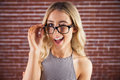 Gorgeous blonde hipster winking Royalty Free Stock Photo