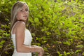Gorgeous blonde teen girl in forest Royalty Free Stock Image