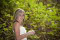 Gorgeous blonde teen girl in forest Stock Image