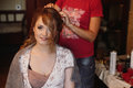 Gorgeous bride getting her hair done by professional stylist. ge Royalty Free Stock Photo
