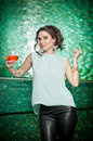 Gorgeous brunette posing near a bright green bar stool Royalty Free Stock Photo