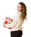 Gorgeous brunette woman holding red gift box Royalty Free Stock Images