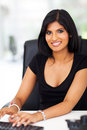 Gorgeous businesswoman typing young indian Royalty Free Stock Photo