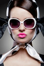 Gorgeous caucasian brunette with sunglasses young stylish woman posing retro styling Royalty Free Stock Photo