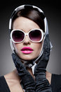 Gorgeous caucasian brunette with sunglasses young stylish woman posing retro styling Royalty Free Stock Photos